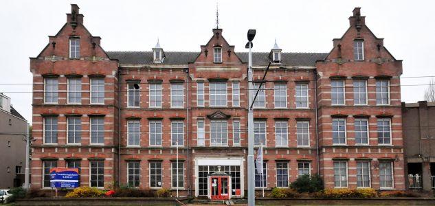 Transformatie vml. ambachtsschool tot 40 lofts in Arnhem
